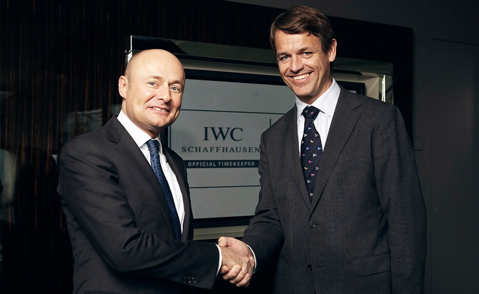 Georges Kern and Knut Frostad shake hands on the partnership